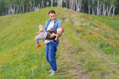 Mother holds her son in her arms royalty free stock photography