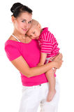 Mother Holds Her Son In Arms, Hugging Him Stock Photo