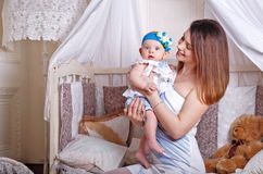 Mother holds the little daughter in her arms. Stock Images