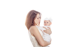 A mother holds a newborn daughter. stock images