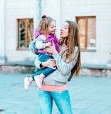 Mother holds a small daughter in her arms Royalty Free Stock Photos