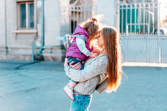 Mother holds a small daughter in her arms Royalty Free Stock Photo