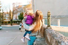 Mother holds a small daughter in her arms Stock Photography