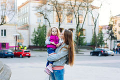 Mother holds a small daughter in her arms Royalty Free Stock Images