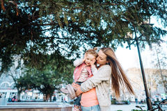 Mother holds a small daughter in her arms Stock Photo