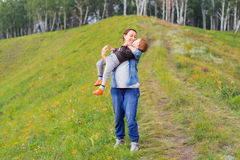 Mother holds son in her arms Stock Photos