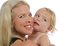 Mother Holds Toddler Daughter Stock Image