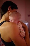 Mother At Home Cuddling Newborn Baby In Nursery Royalty Free Stock Images