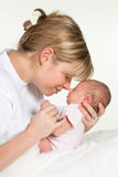 Mother hugging baby Stock Image