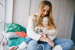 Mother hugging baby daughter stock photo