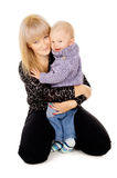 Mother hugging baby Stock Photography