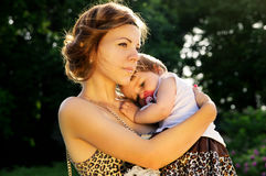 Mother Hugging Baby On Sunset Royalty Free Stock Photo