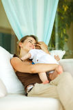 Mother hugging baby at terrace Royalty Free Stock Image