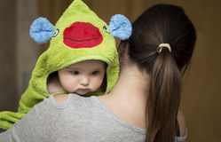 Mother hugging baby wrapped in a towel after bath Royalty Free Stock Photo