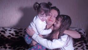 Mother hugging children. stock footage