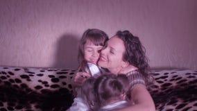 Mother hugging children. stock video