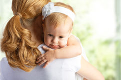 Mother hugging and comforting her baby daughter. Young mother hugging and comforting her baby daughter Royalty Free Stock Photo