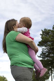 Mother hugging daughter. Obese mother hugging her lovely toddler daughter Royalty Free Stock Image