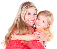 Mother hugging daughter Stock Photos