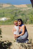 Mother Hugging Daughter Stock Images