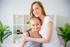 Mother hugging daughter. A portrait of a mother hugging daughter Royalty Free Stock Image