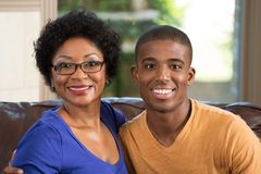 Mother hugging her adult son. African American mother hugging her adult son Royalty Free Stock Photography