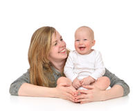 Mother hugging in her arms child baby kid girl smilling. Young mother women holding and hugging in her arms child baby kid girl smilling laughing on a white royalty free stock photo