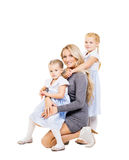 Mother Hugging Her Beautiful Daughters Isolated On White. Family Royalty Free Stock Photos