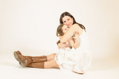 Mother hugging her beautiful little girl. Royalty Free Stock Photography