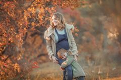 Mother hugging her child during walk in the park stock images