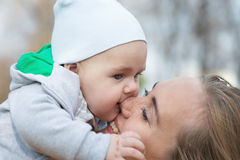 A mother hugging her cute little son Stock Images