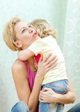 Mother hugging her daughter Royalty Free Stock Images