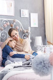 Mother hugging her daughter Stock Image