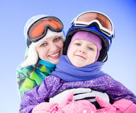 Mother hugging her daughter at the ski resort Stock Photos