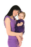 Mother hugging her little daughter Stock Photography