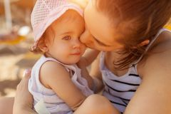 Mother hugging with her little daughter outdoor in nature on sunny day Positive human emotions, feelings, emotions. Portrait of happy family on the vacation royalty free stock photography