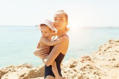 Mother hugging with her little daughter outdoor in nature on sunny day Positive human emotions, feelings, emotions. Portrait of happy family on the vacation stock image