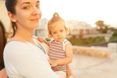 Mother hugging with her little daughter outdoor in nature on sunny day Positive human emotions, feelings, emotions. Portrait of happy family on the vacation royalty free stock photo
