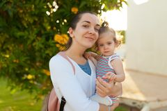 Mother hugging with her little daughter outdoor in nature on sunny day Positive human emotions, feelings, emotions. Portrait of happy family on the vacation stock photography