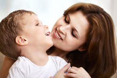 Mother hugging her little son Stock Photos