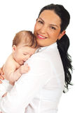 Mother hugging her newborn son Stock Photos