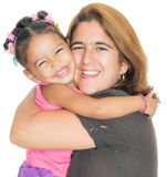 Mother hugging her small multiracial daughter stock image