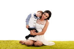 Mother hugging her son Stock Images