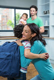 Mother hugging her son. In kitchen at home stock photos