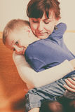 Mother hugging her son, little boy. Family love, beauty of parenting concept. Mother hugging her son, little young boy royalty free stock photos