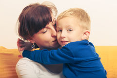 Mother hugging her son, little boy. Family love, beauty of parenting concept. Mother hugging her son, little young boy royalty free stock image