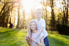Mother hugging her son. Mother`s Day. Happy family in the park royalty free stock photography