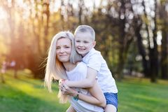 Mother hugging her son. Mother`s Day. Happy family in the park stock image