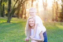 Mother hugging her son. Mother`s Day. Happy family in the park royalty free stock images