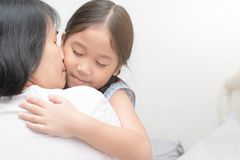 Mother hugging and kiss her daughter. Mother hugging and kiss her daughter, love and care concept Royalty Free Stock Photo
